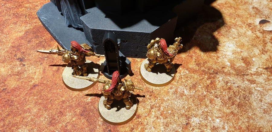 Custodes on a battlefield